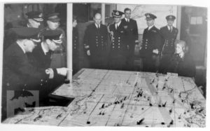 King George VI being shown the operations map at Fort Southwick.